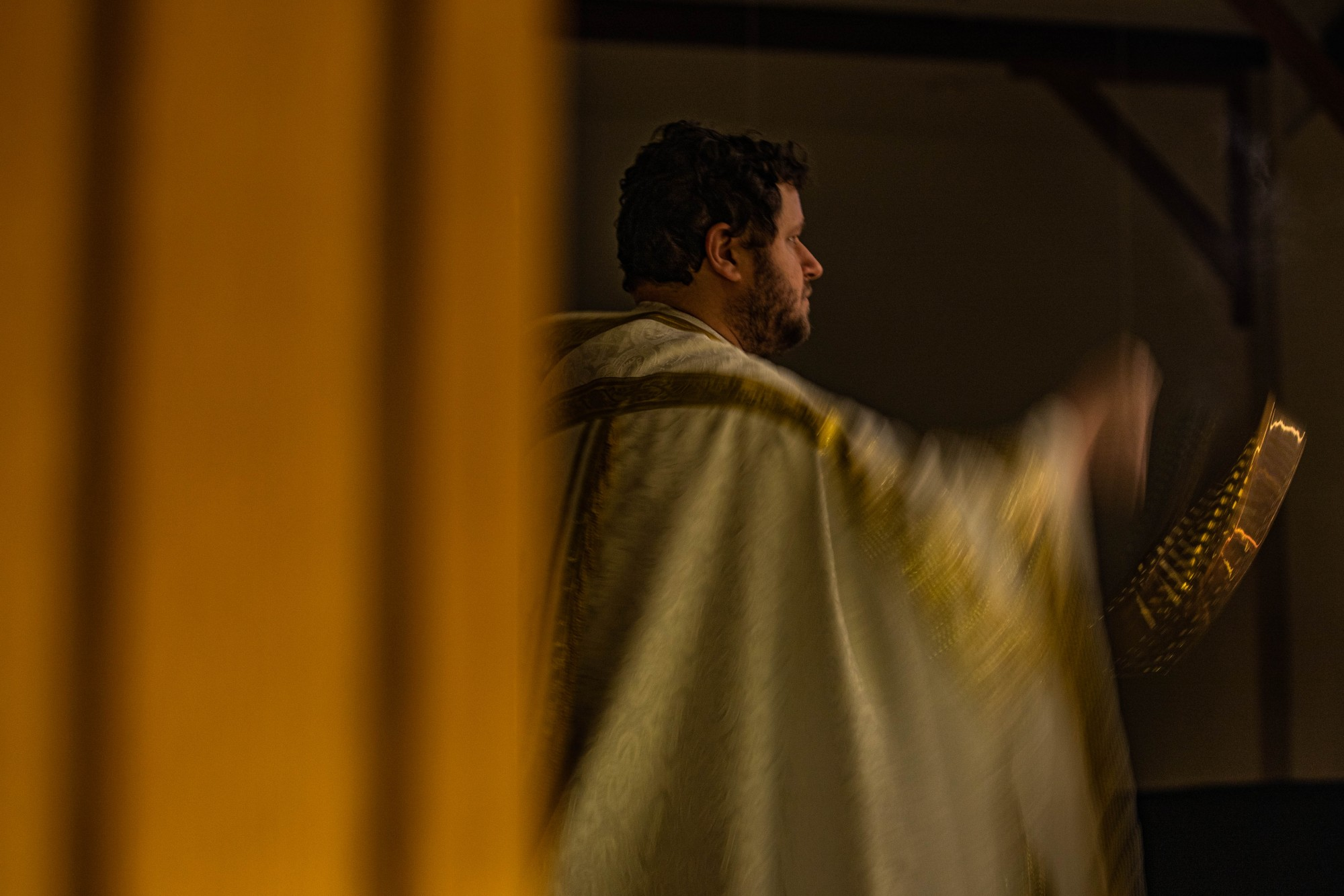 The Rev. Fr. Matthew Gossett burns incense during mass at the Christ the King University Parish Catholic Church in Athens, Ohio, on Wednesday, Sept. 16, 2020.
