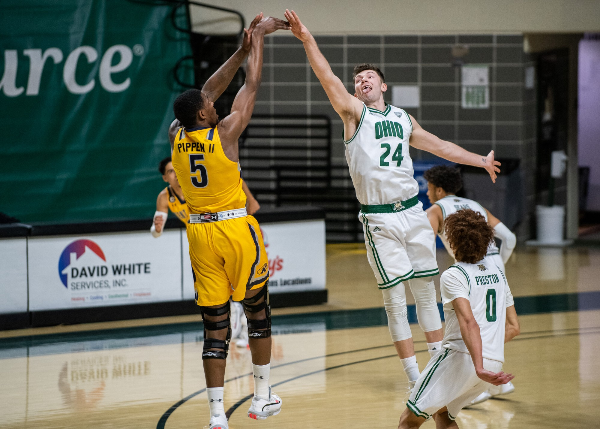 Ohio University forward Mason McMurray (24) tries to block Kent State forward Danny Pippen (5) from shooting the ball on Saturday, Jan. 16, 2021. Ohio University lost 89- 79 to Kent State. (FILE)
