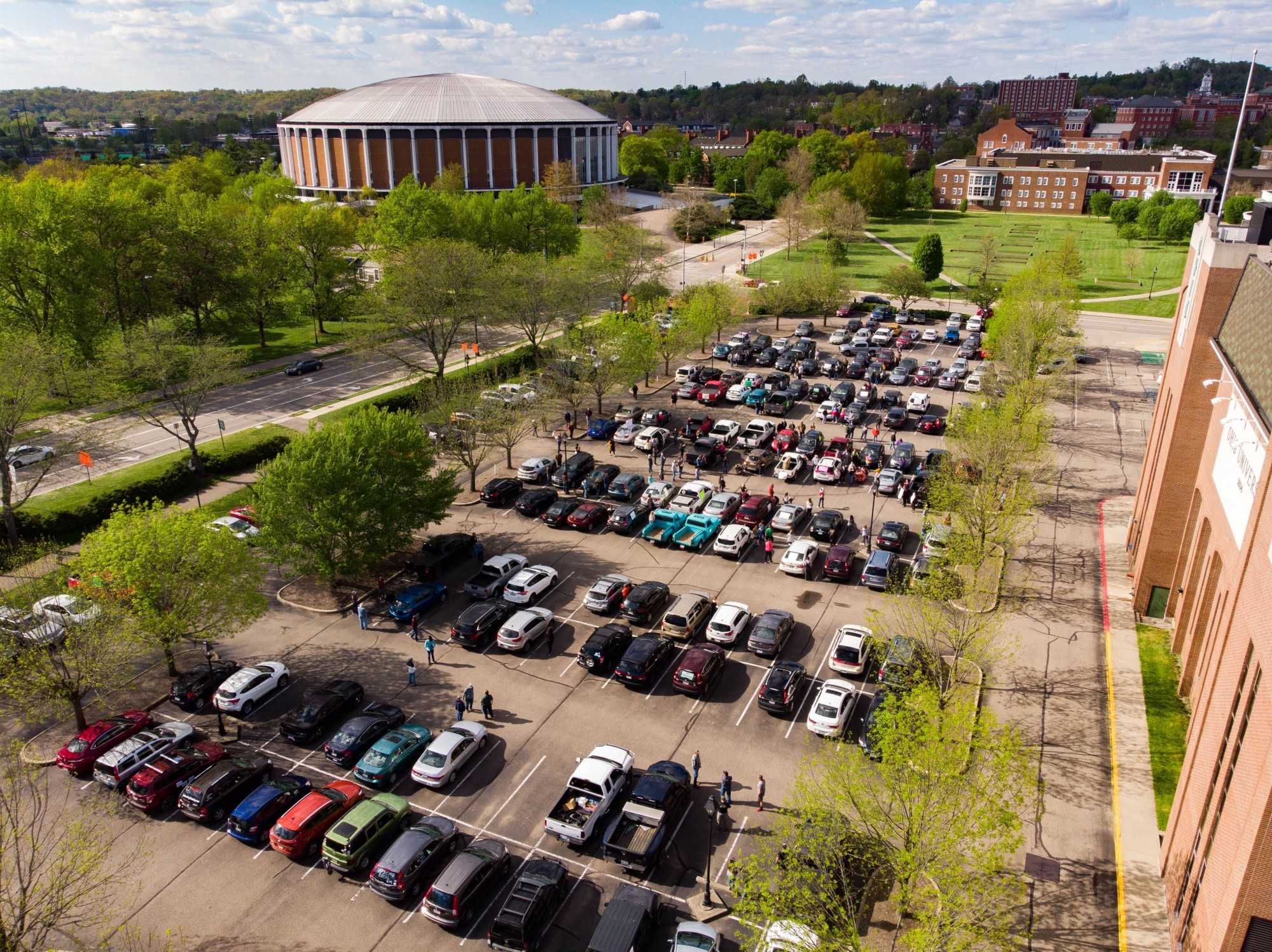 Approximately 200 people rallied in their vehicles outside Peden Stadium in protest of Ohio University laying off 140 union employees on Wednesday, May 6, 2020. (Kevin Pan | For The Post).