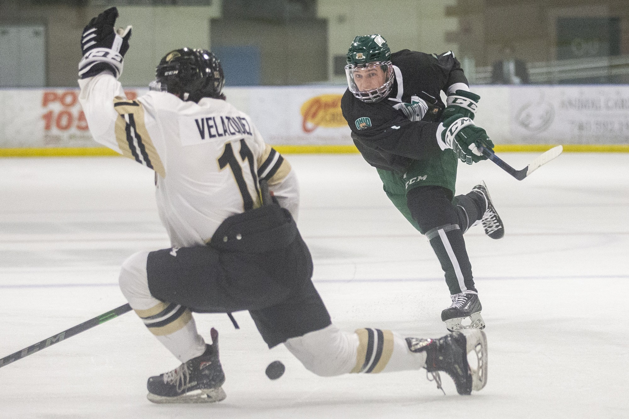 Ohio defenseman Blake Rossi (#7) fires a shot on net during the Ohio hockey game against Lindenwood on Friday, March 12, 2021, at the Bird Arena in Athens, Ohio. The Bobcats beat the Lions 3-0.