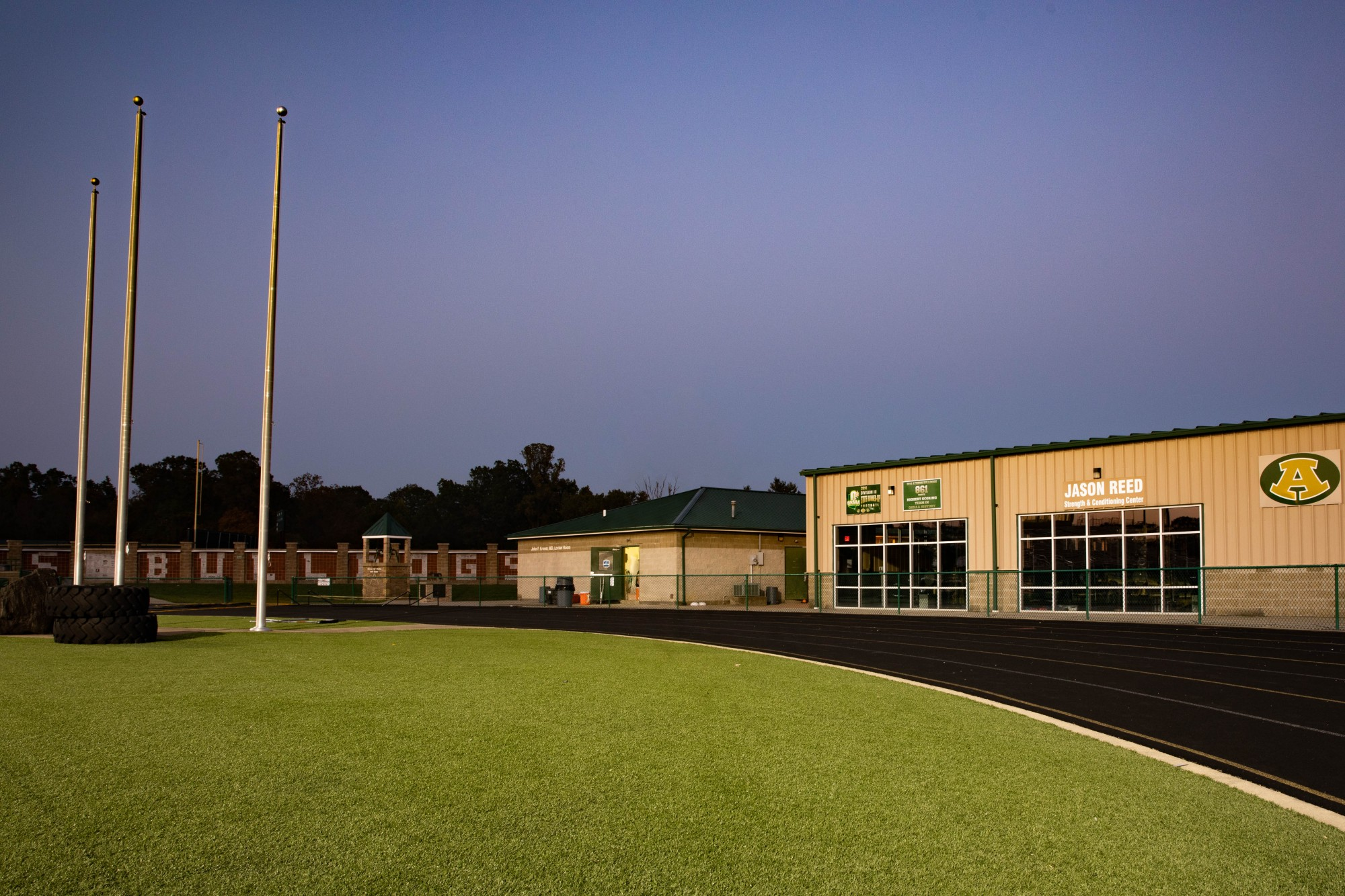 The John F. Kroner, MD, Locker Room and Jason Reed Strength and Conditioning Center at the east end of the Athens High School stadium in The Plains, Ohio.