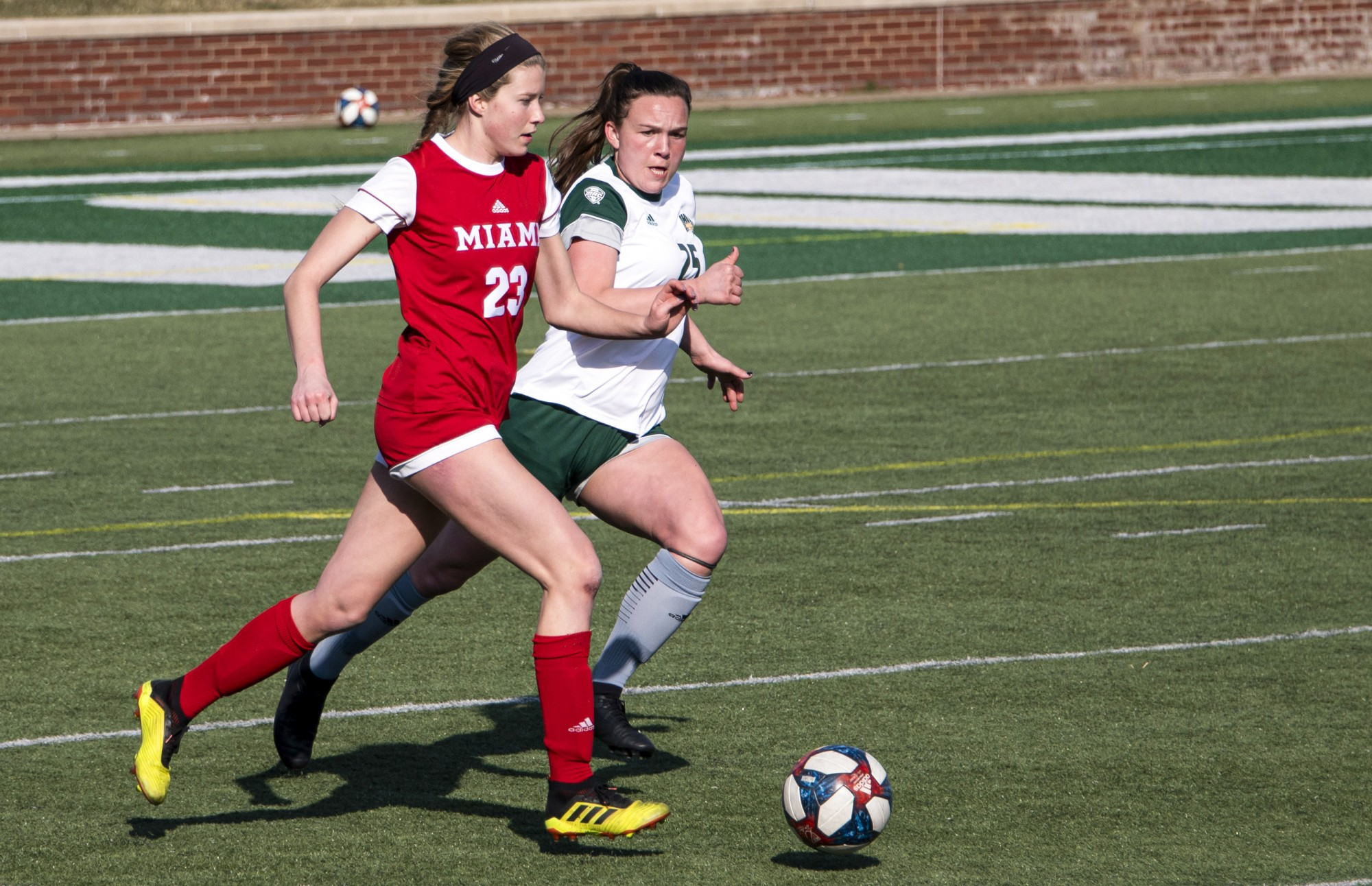 Izzi Boyd (#25) races for possession of the ball during the Ohio University home game at Peden Stadium in Athens, Ohio, on March 4, 2021. The Bobcats lost to the Redhawks 0-1. (FILE)