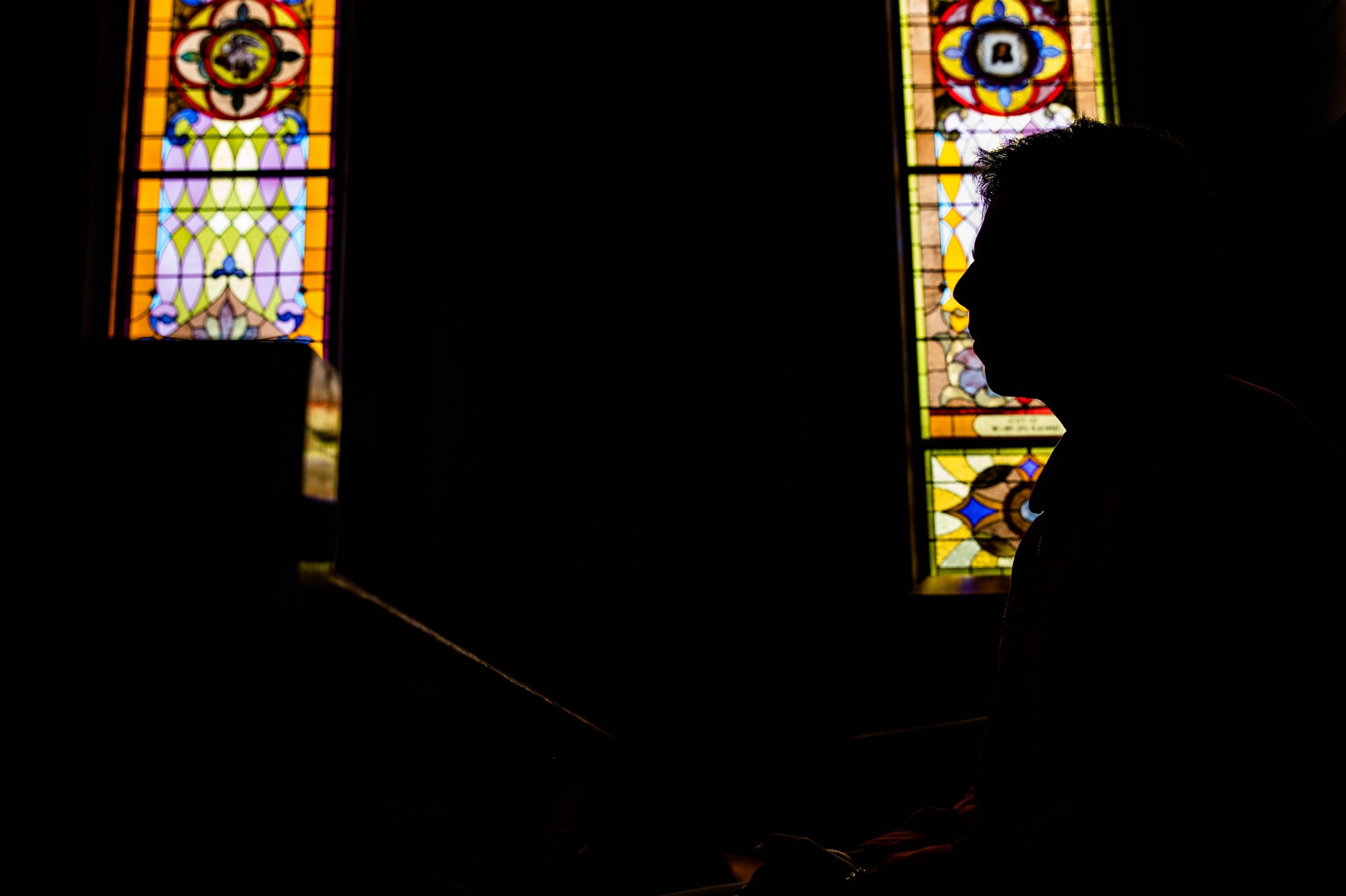 Michael Massinople, a Catholic student at Ohio University, sits at a pew inside St. Paul Catholic Church in Athens, Ohio, on Wednesday, Sept. 16, 2020.