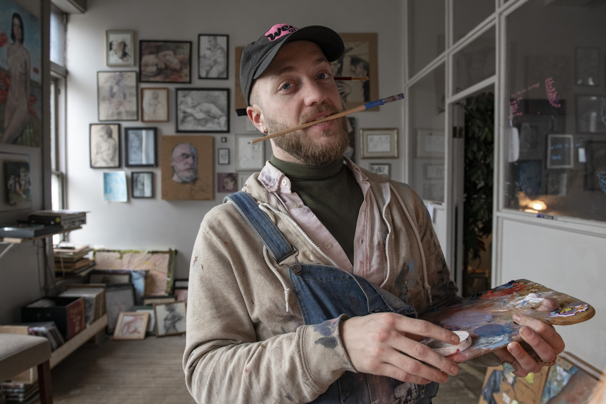 Bennett Ritchie poses for a portrait in his art studio in Richmond, Indiana, as he works on a commission on December 24, 2020.