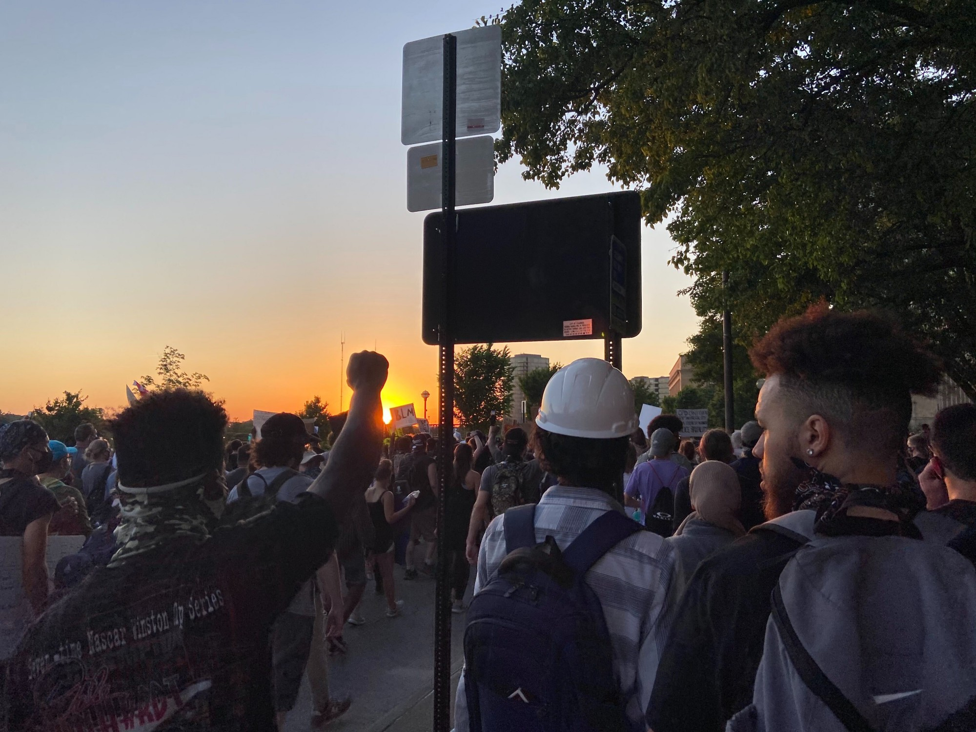 People continue to protest as the sun goes down.