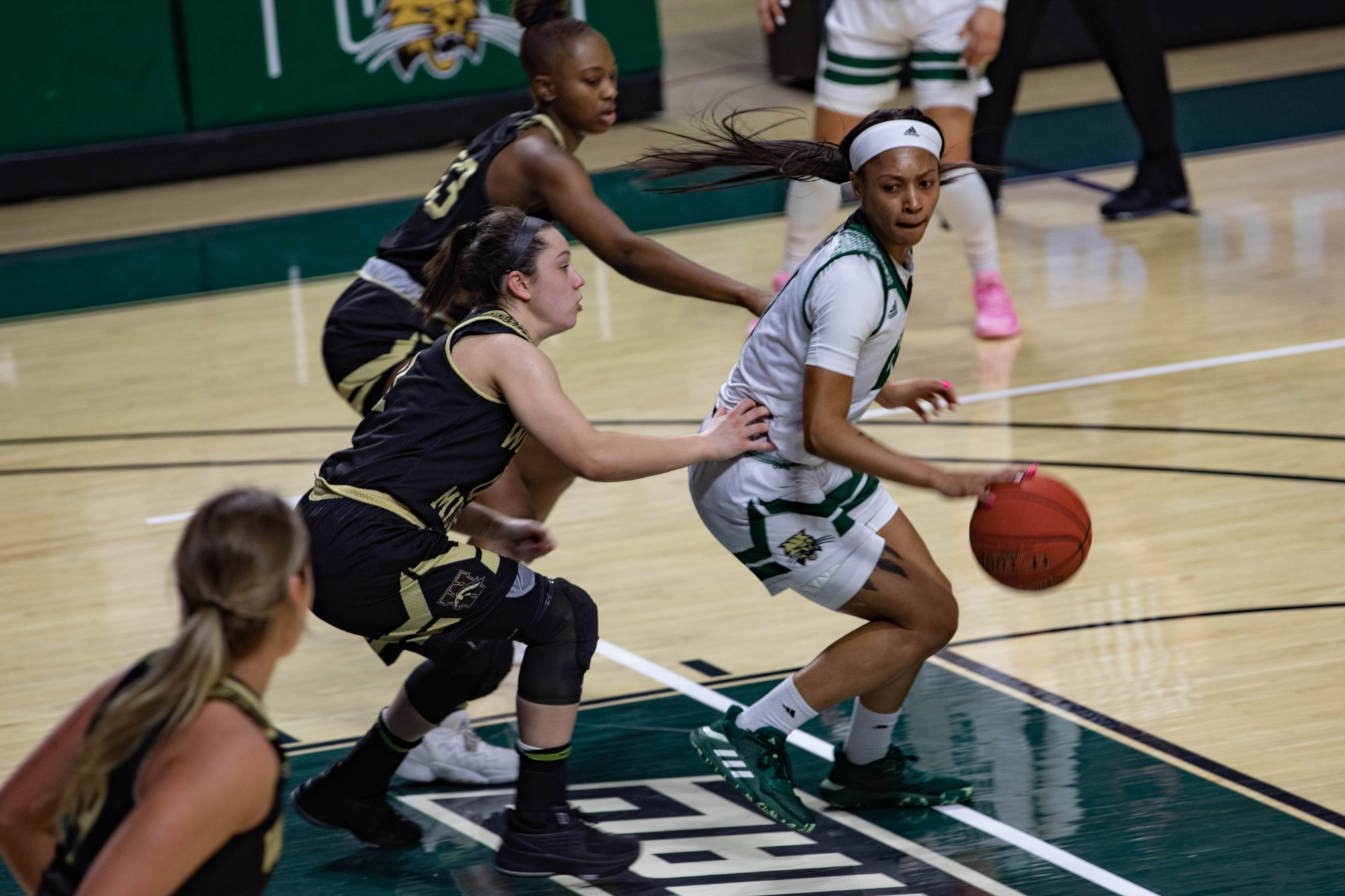 Ohio guard Cece Hooks (#1) dribbles past Western Michigan University in the second quarter of a match held at the Convocation Center on Saturday, Feb. 13, 2021.