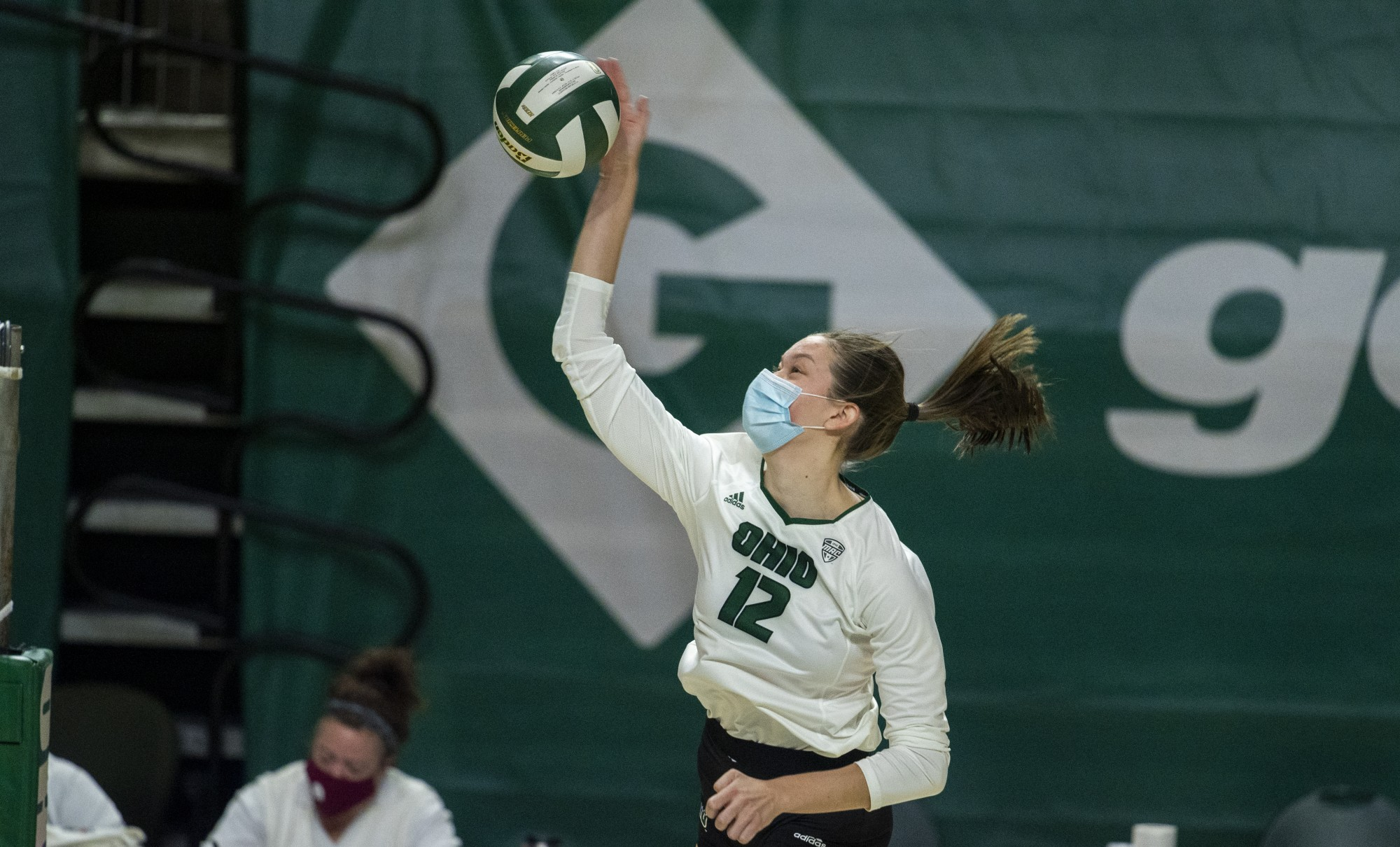 Redshirt freshman, Caitlin O'Farrell (12), hits the ball during the Bobcats first home game on Friday, Jan. 22, 2021. The game was postponed to Saturday due to a county wide blackout.