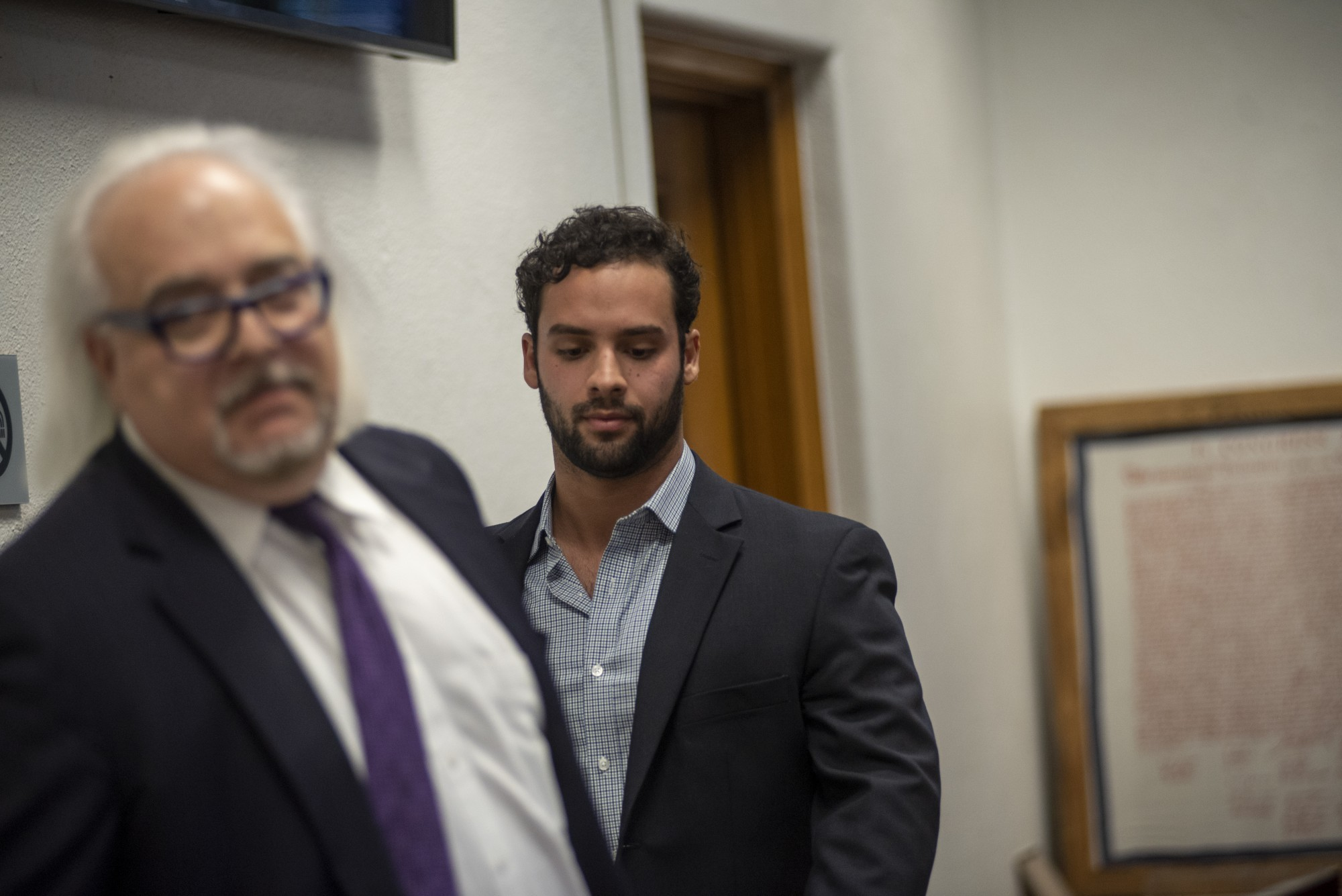 Former Ohio University student, Elijah Wahib, walks out of court behind his lawyer, Paul Wolf, after his arraignment hearing on Thursday, Nov. 21, 2019. (Kelsey Boeing | Director of Photography)