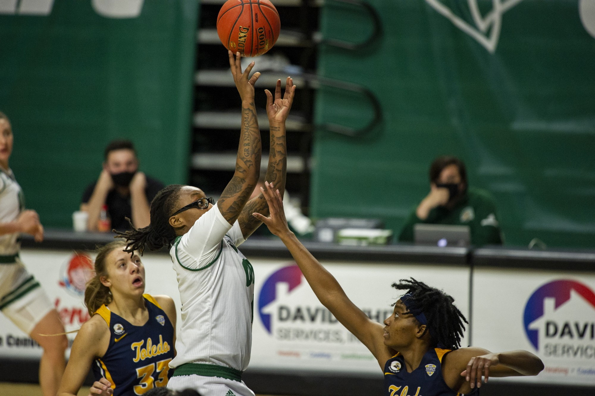Ohio University's, Erica Johnson (4) goes up for a quick shot with heavy pressure from The University of Toledo's, Hallie Idowu (35) and Sammi Mikonowicz (33), during the home game on Saturday, Jan. 9, 2021 in Athens, Ohio.