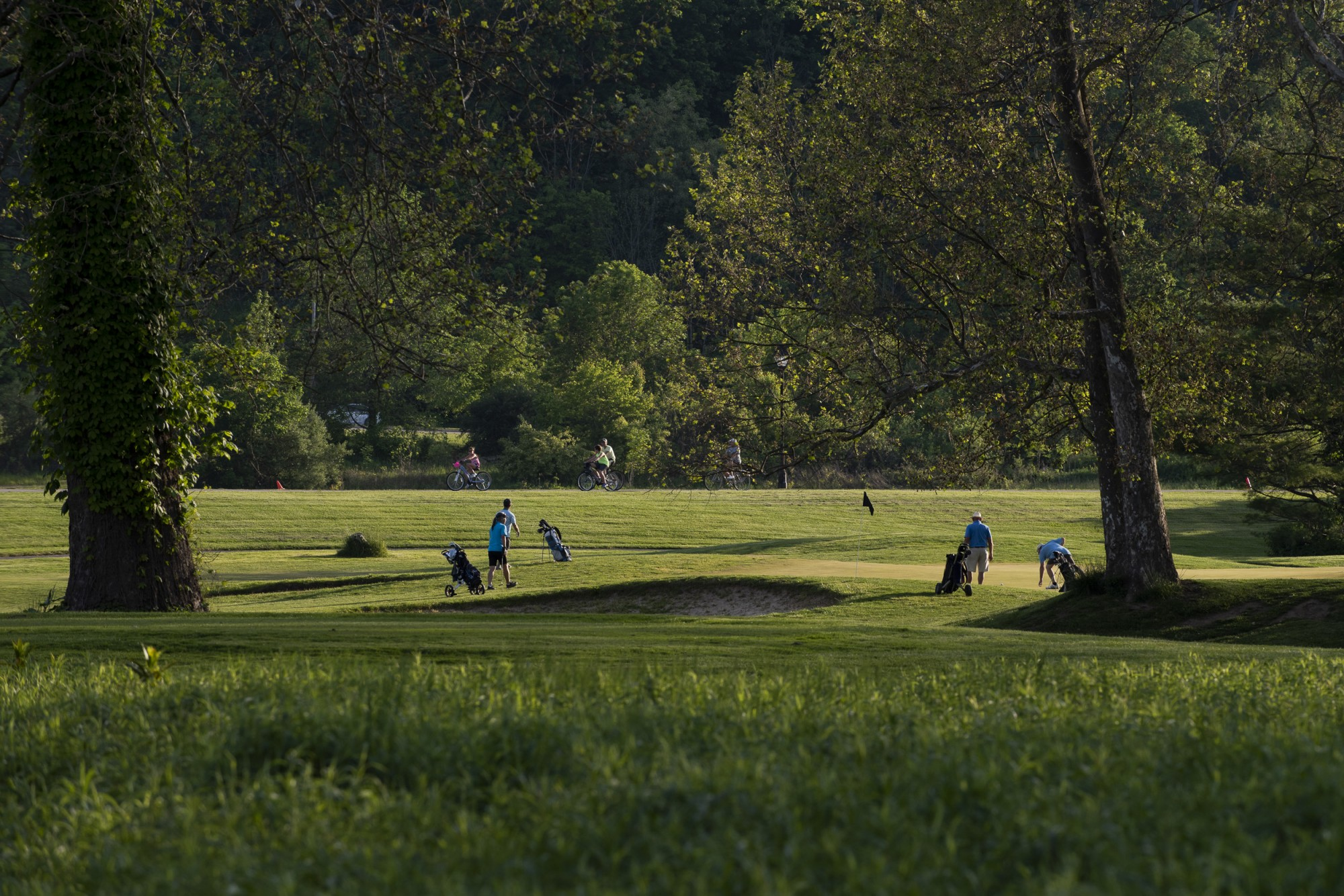 Members of the Athens County Ohio Golf league play on hole seven of the Ohio University golf course on May 19, 2021.