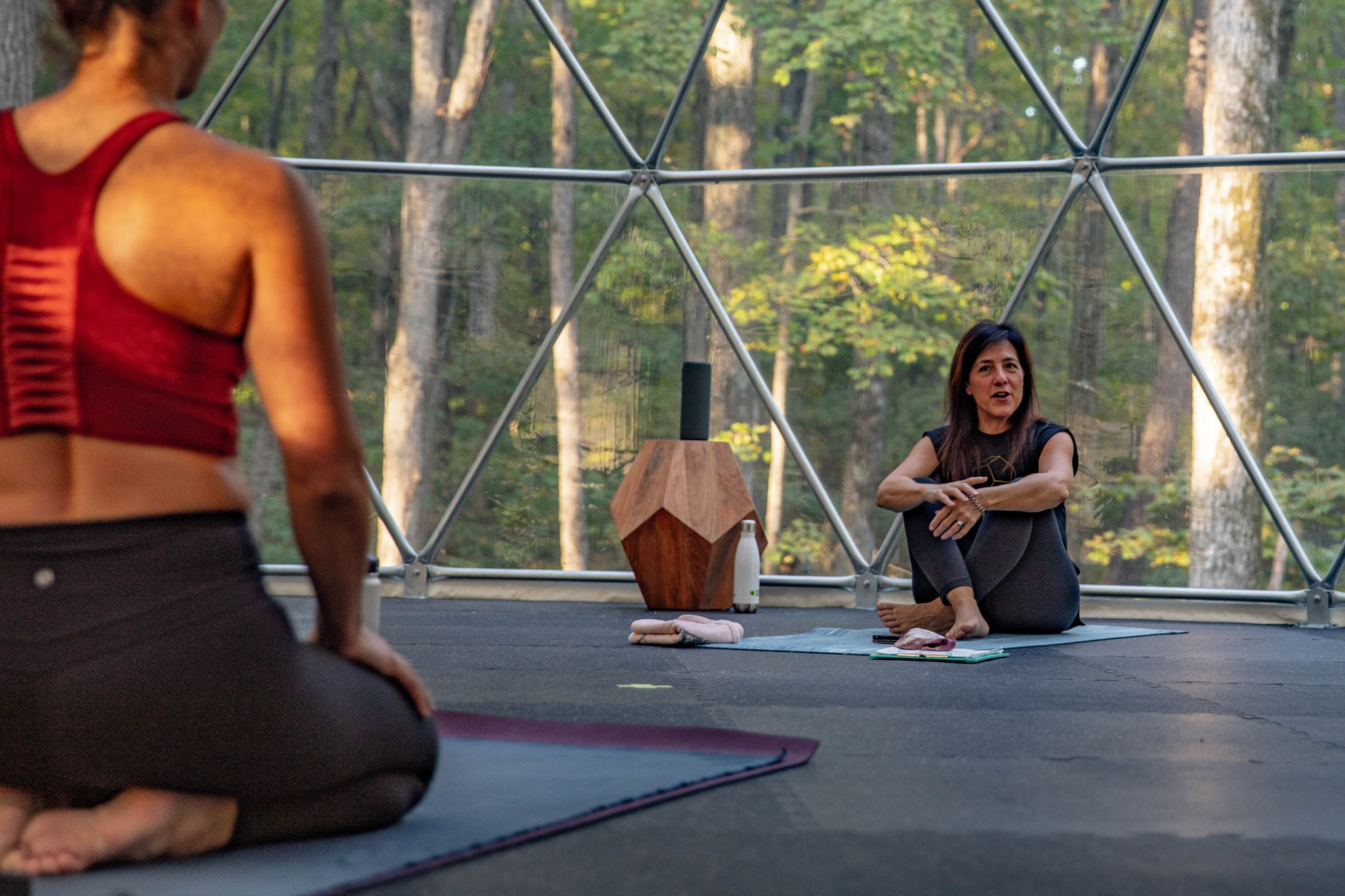 Prior to class, Geode Yoga + Fitness instructor Marci Hedderson-Caroll talks with the students in her hot power yoga class on the evening of Monday, Oct. 5, 2020.