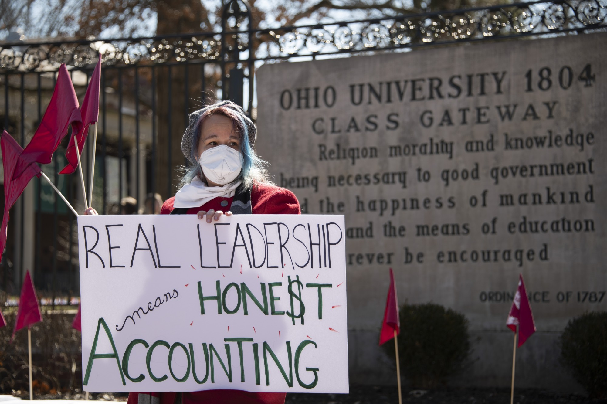 Ohio University faculty and Athens community members gathered outside of the class gateway, on college green, in support of the faculty that was laid off last spring on Wednesday March 3, 2021 in Athens, Ohio.