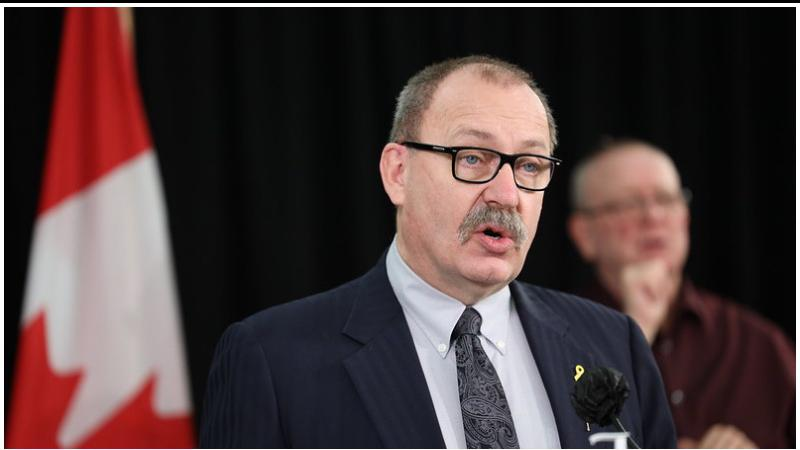 Alberta leader reverses course, punishes for pandemic travel