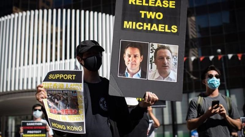 China sets court hearings for two Canadians accused of spying