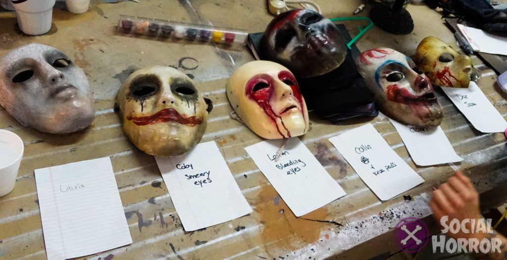 "Masks of Nelson's own design, all laid out for ""scareachters"" to don on opening night."