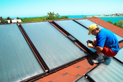 Solar collection cells getting set up at a Seattle home