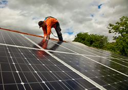 Contractor setting up solar power collection system