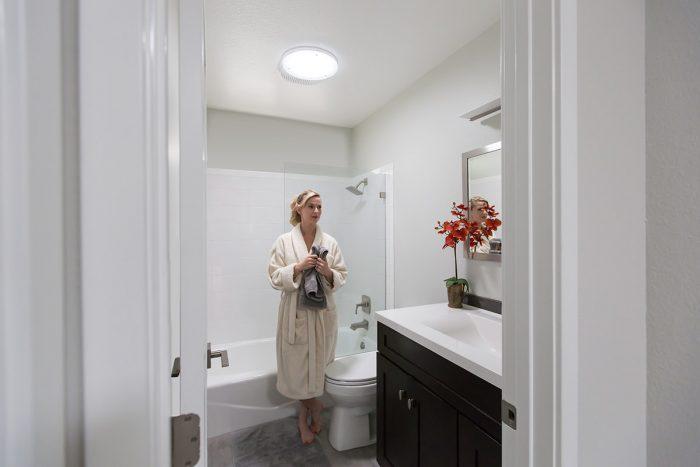 Woman in Daylit Bathroom