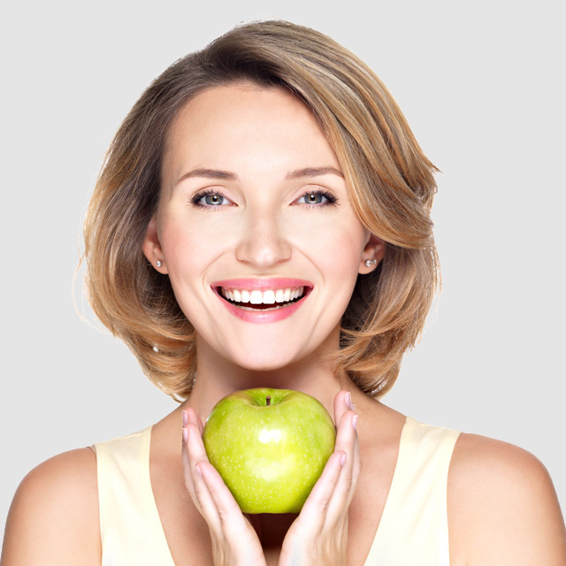 image of woman eating apple