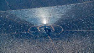flying over desert solar collector close