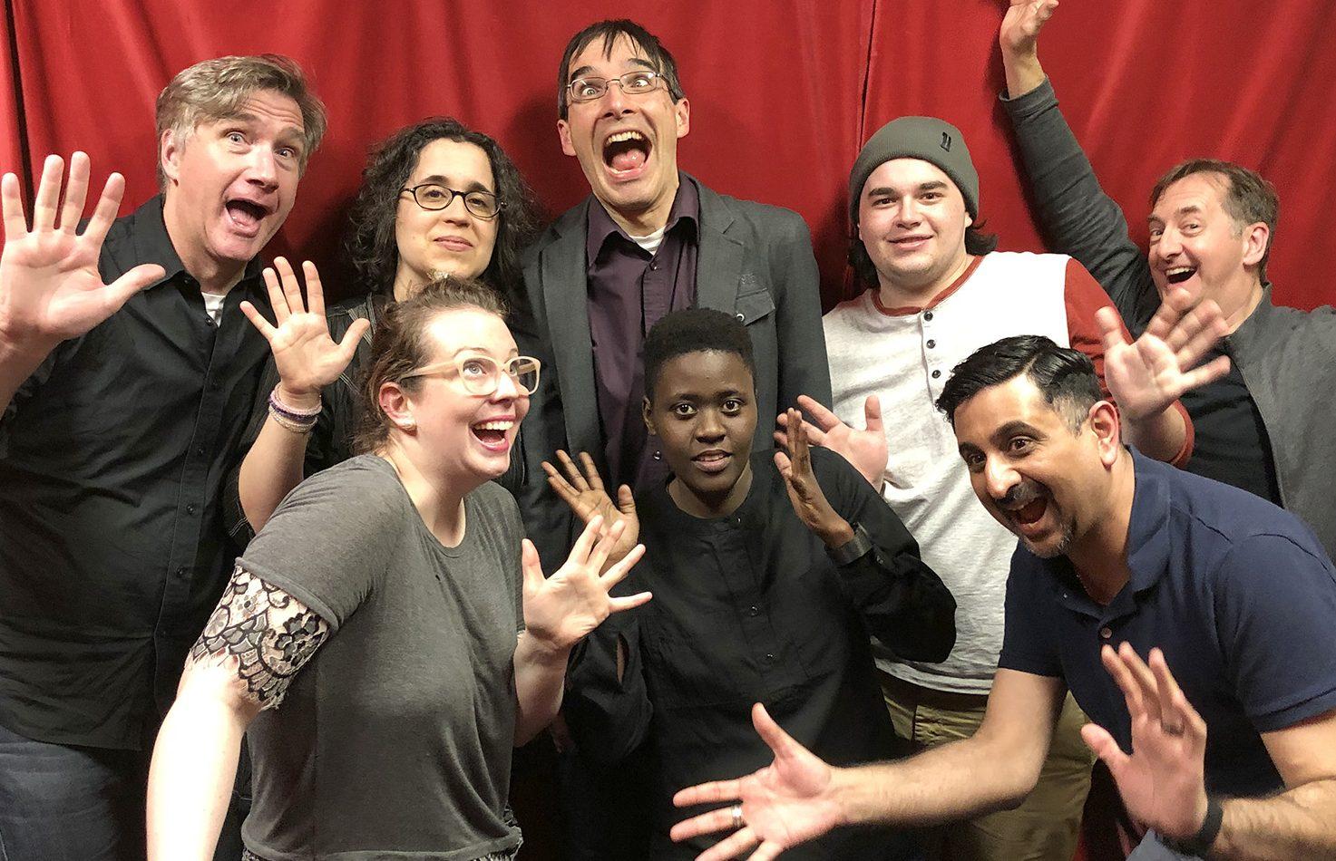 Back row: Phil, Lisa, Frank, Micah, and Michael. Front row: Vanessa, Ritah, and Neel