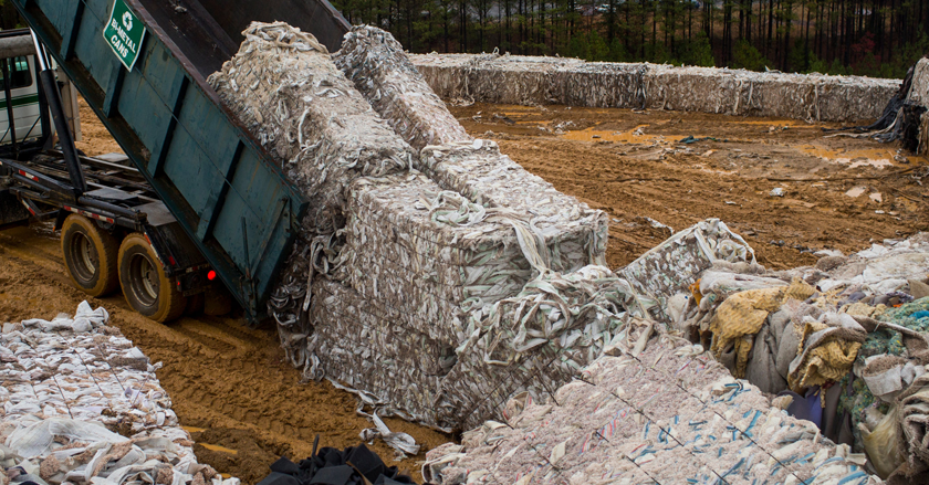 carpet being dumped in a landfill