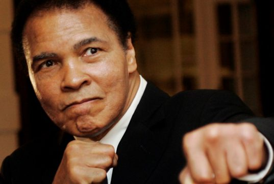 Muhammad Ali poses during the World Economic Forum in Davos, Switzerland January 2006. REUTERS/Andreas Meier