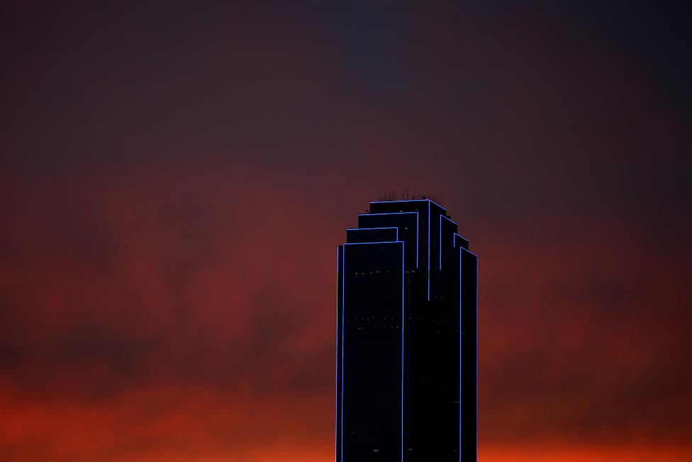 The Bank of America building is lit up in blue, the traditional color of police uniforms as a tribute following the multiple police shootings in Dallas
