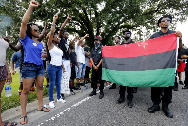 Demonstrators protest the shooting death of Alton Sterling near the headquarters of the Baton Rouge Police Department in Baton Rouge, Louisiana