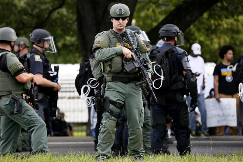A police officer is seen near the headquarters of the Baton Rouge Police Department in Baton Rouge, Louisiana