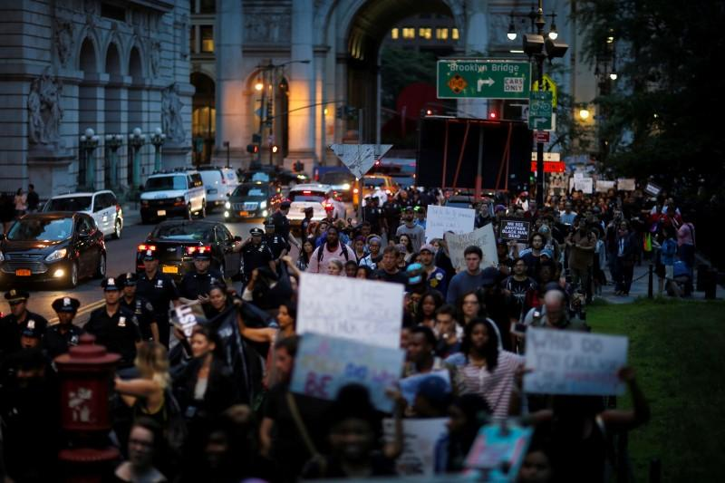 People take part in a protest against police brutality and in support of Black Lives Matter durimg a march in New York