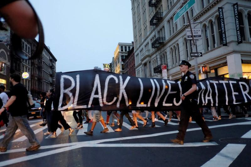 People take part in a protest against police brutality and in support of Black Lives Matter during a march in New York