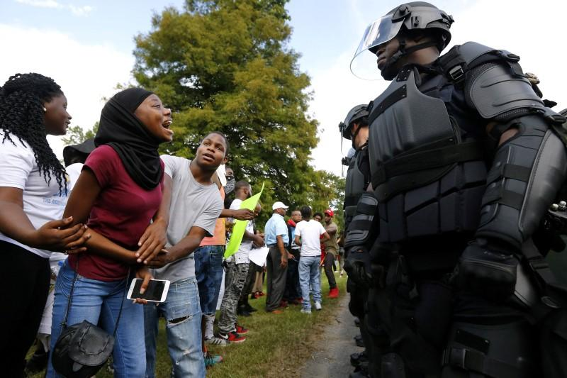 Demonstrators protesting the shooting death of Alton Sterling gather near the headquarters of the Baton Rouge Police department in Baton Rouge, Louisiana