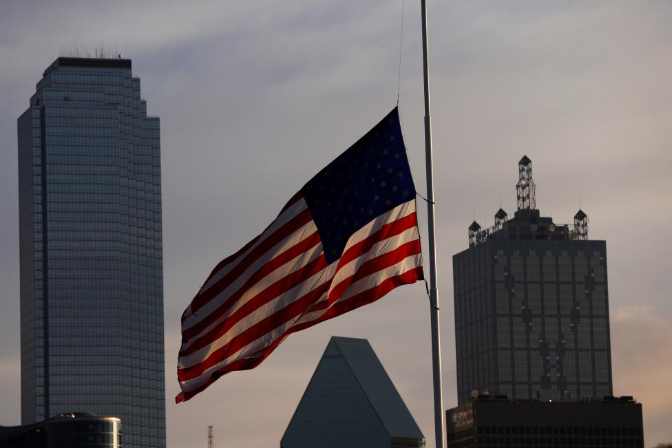 The U.S. flag flutters at half mast, two days after a lone gunman ambushed and killed five police officers at a protest decrying police shootings of black men, in Dallas, Texas