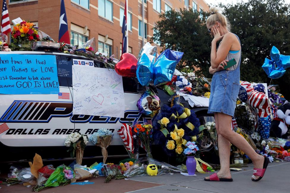 Melinda Martin visits a makeshift memorial at Dallas Police Headquarters two days after a lone gunman ambushed and killed five police officers at a protest decrying police shootings of black men, in Dallas, Texas