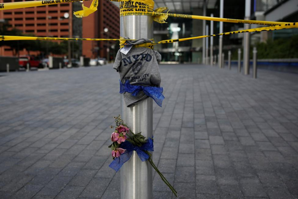 A NYPD tee shirt on makeshift memorial near crime scene two days after a lone gunman ambushed and killed five police officers at a protest decrying police shootings of black men, in Dallas, Texas