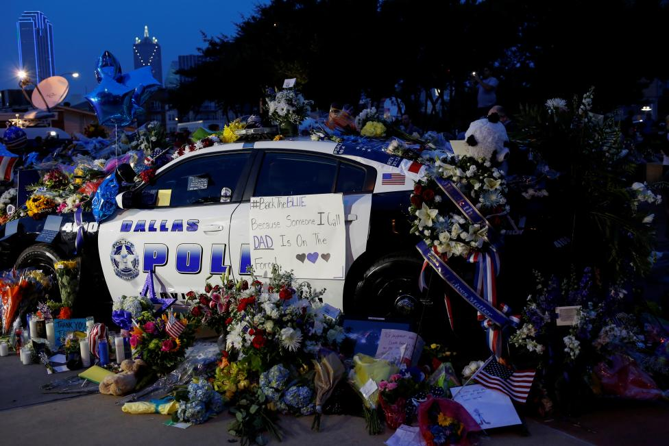 A makeshift memorial at Dallas Police Headquarters one day after a lone gunman ambushed and killed five police officers at a protest decrying police shootings of black men, in Dallas, Texas