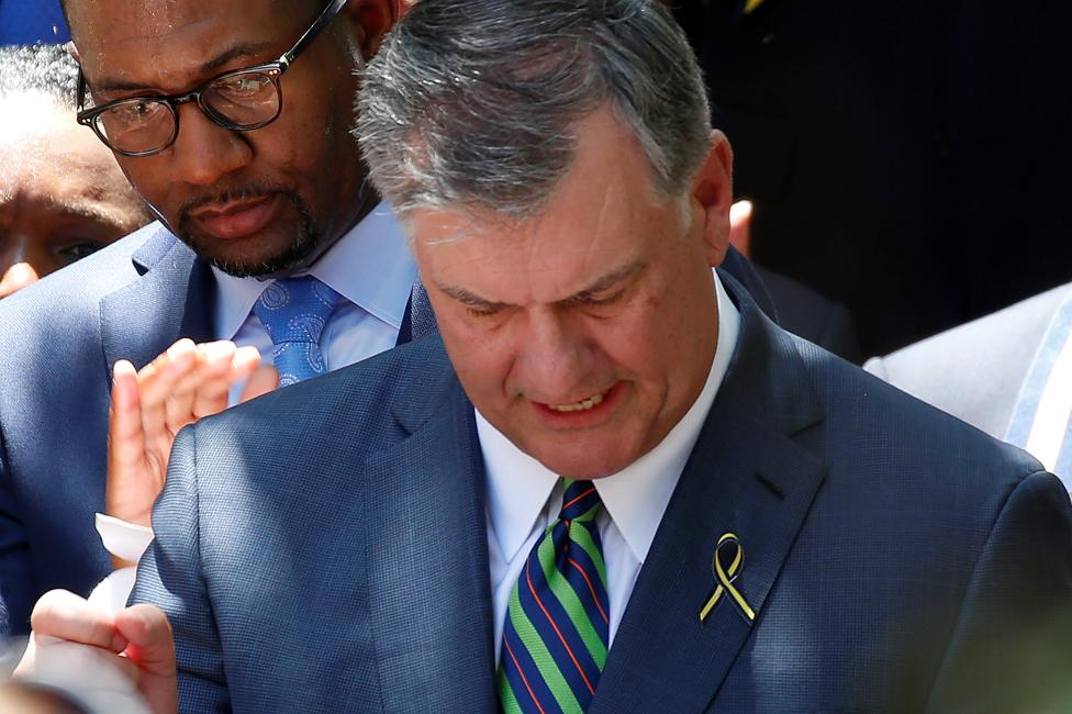 The mayor of Dallas Mike Rawlings takes part in a prayer vigil in a park following the multiple police shooting in Dallas