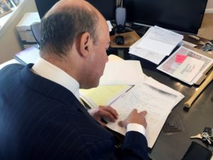 Ari Fleischer looks over 9/11 notes during an interview with Reuters in his office in Bedford, New York, U.S. September 7, 2016. Picture taken September 7, 2016. REUTERS/Hussein Waaile