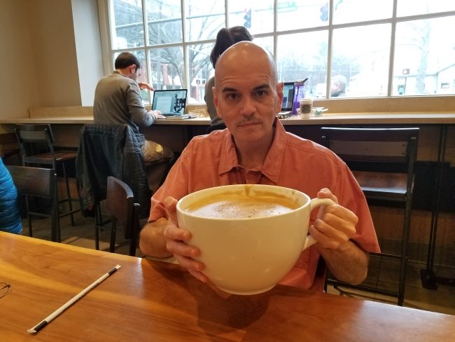 "Bill Lewis ready to sip his ""most expensive Starbucks coffee"" ©SouthFloridaReporter.com"
