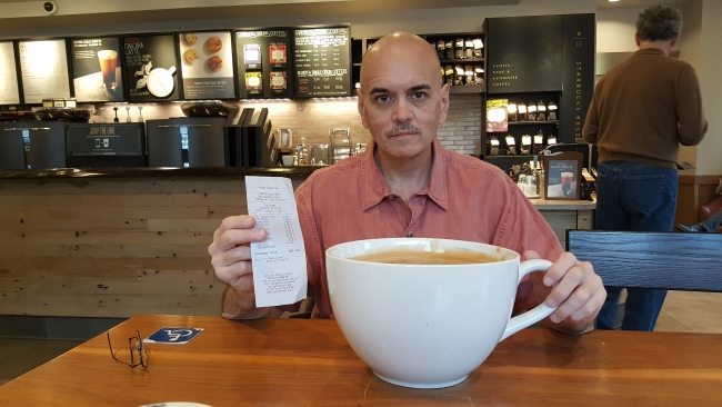 "Bill Lewis with the receipt and cup of ""most expensive Starbucks coffee"" ©SouthFloridaReporter.com"