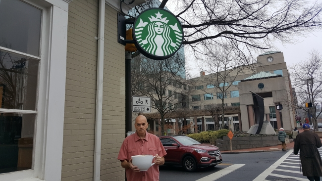 "Bill Lewis outside the Bethesda Starbucks with his ""most expensive Starbucks coffee"" ©SouthFloridaReporter.com"