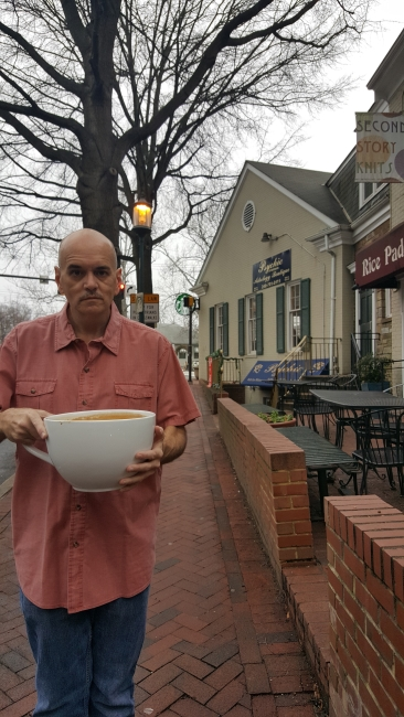 "Bill Lewis and his cup of ""most expensive Starbucks coffee"" ©SouthFloridaReporter.com"