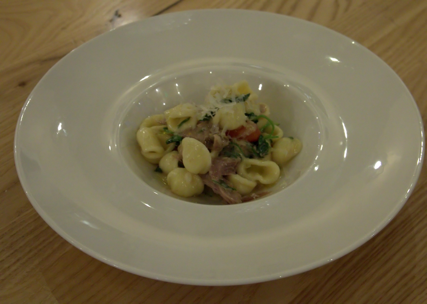 Orecchiette with duck confit, cherry tomatoes, zucchini, peas and Parmesan cheese