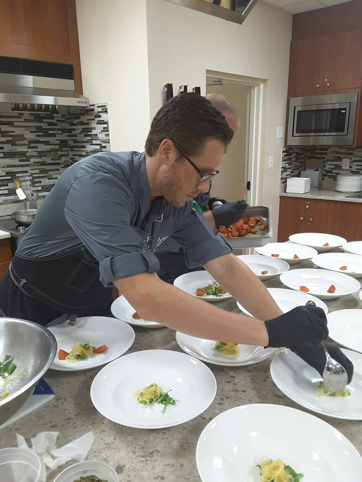 Chef Roland preparing dishes