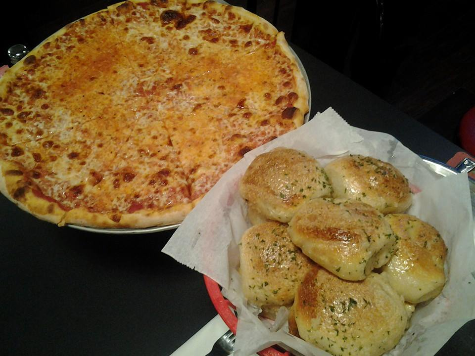 Cheese pizza and a basket of garlic rolls