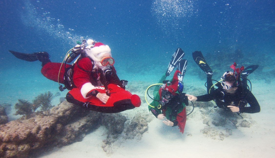 Christmas In Florida Keys.Santa Scuba Dives As He Readies For Christmas Deliveries