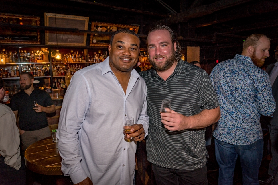 Co-chair, presenting sponsor and Big Brothers Big Sisters board member Chad Van Horn (right) of Van Horn Law Group, P.A. with former Dolphin Shawn Wooden