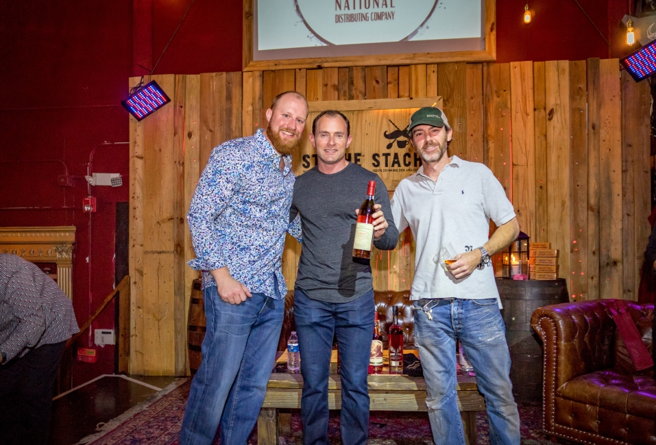 Auction winner Thomas Burkett with Scott Weiselberg and Brian Freed
