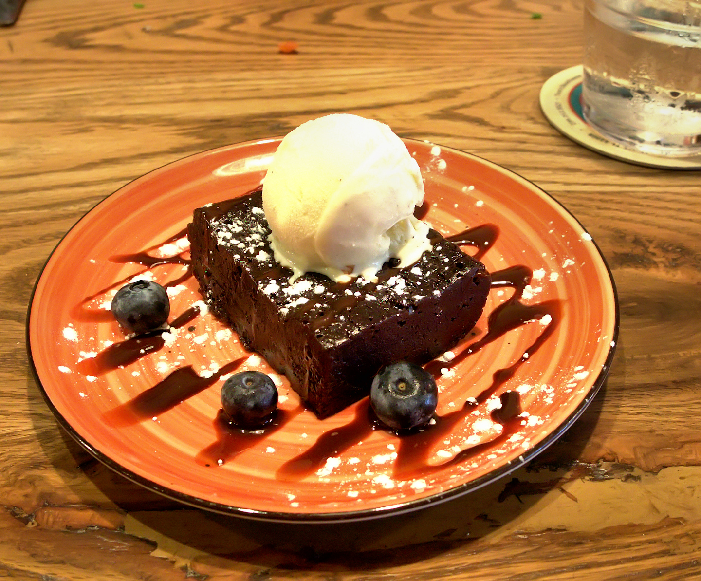 Hatch chili red wine sauce brownie with vanilla ice cream